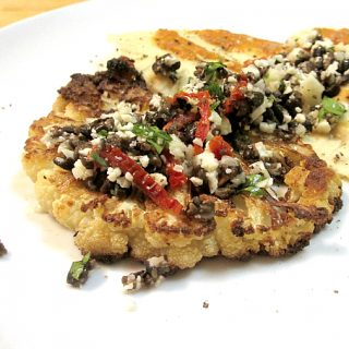 Roasted cauliflower steaks with olive relish and tomato sauce