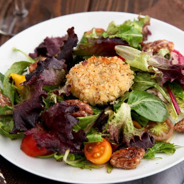 Baked goat cheese medallions encrusted with almonds - perfect served warm over salad greens!