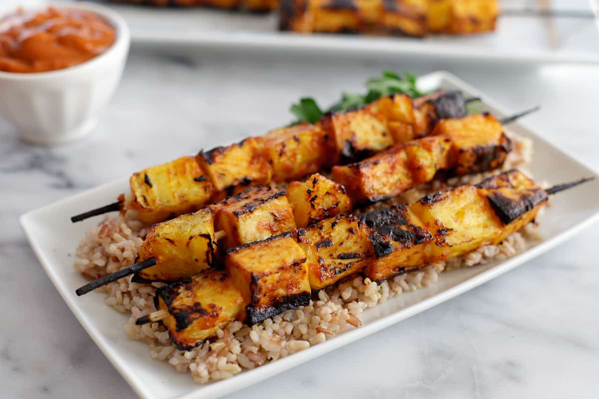 ... Grilled pineapple tofu skewers with spicy mango BBQ sauce ( *recipe at