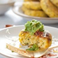 Zucchini arepas: zucchini corn cakes with cheese, salsa, and guacamole