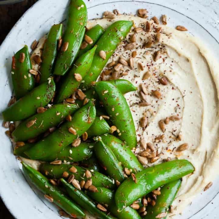 Harissa Snap Peas with Cashew Hummus & Sunflower Seed Za'atar