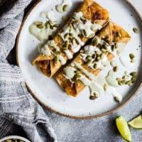 Cheesy Pumpkin Taquitos with Roasted Jalapeño Pepita Crema