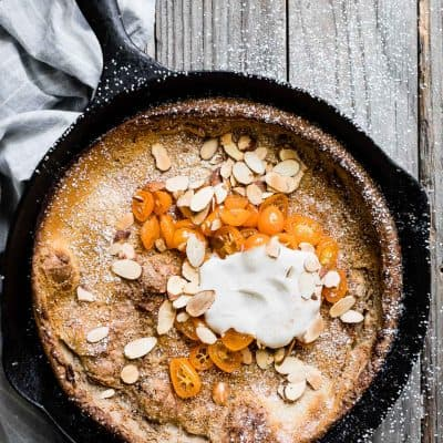 Gluten-Free Almond Dutch Baby with Honeyed Kumquats and Vanilla Creme Fraiche
