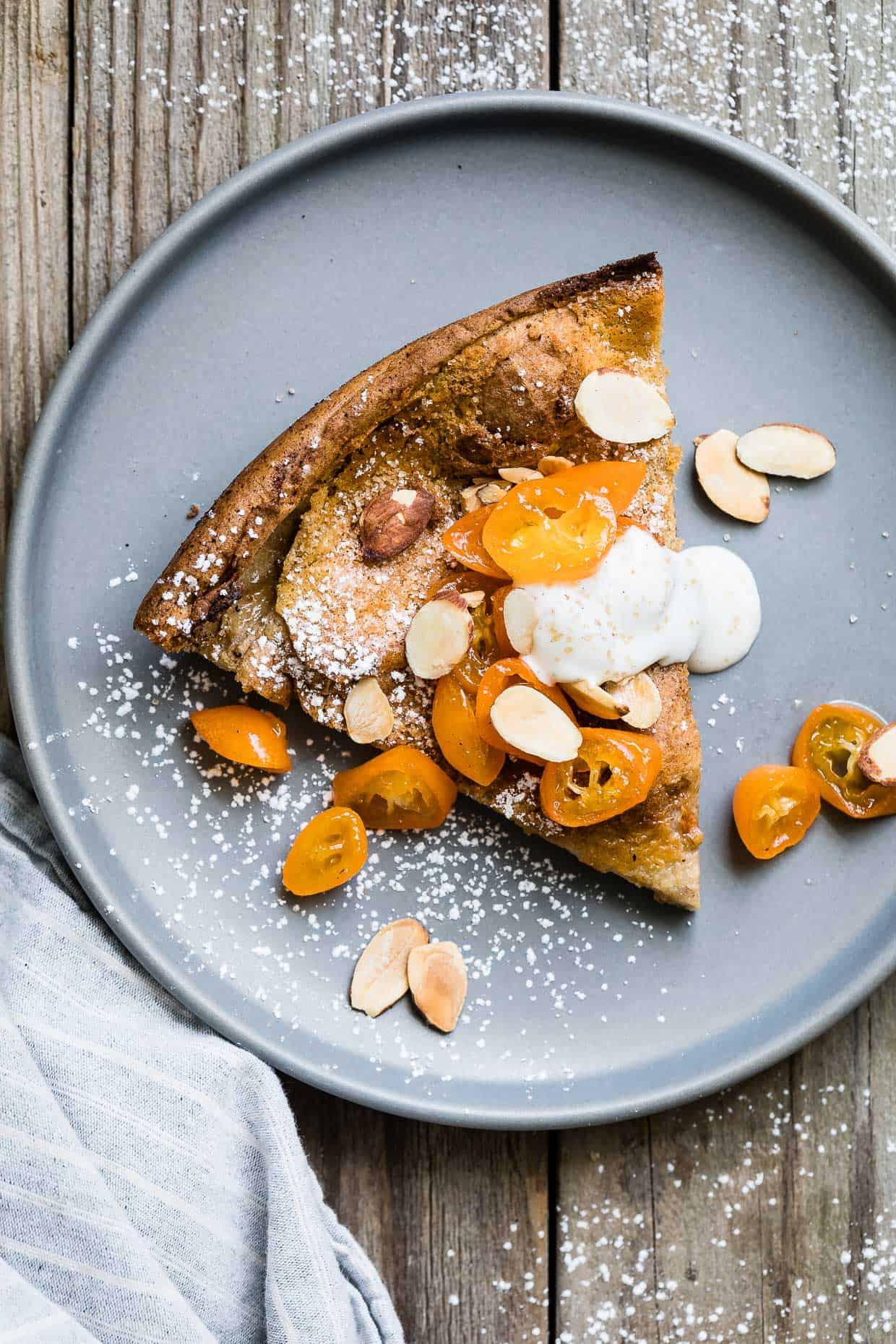 Gluten-Free Almond Dutch Baby with Honeyed Kumquats and Vanilla Creme Fraiche