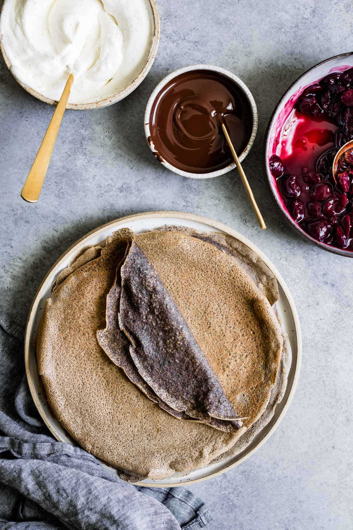 Buckwheat Crepes with Roasted Cherries, Whipped Cream, and Chocolate