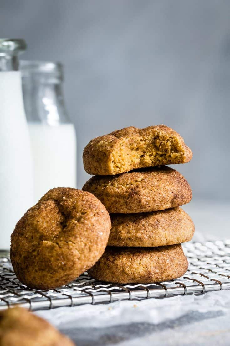 These gluten-free pumpkin cookies are soft and pillowy and studded with toasted walnuts. Rolled in cinnamon sugar, they taste like pumpkin snickerdoodles! #pumpkincookies #pumpkin # glutenfree #glutenfreecookies #fall #baking #recipe #pumpkinspice #snickerdoodles #cookies #walnuts