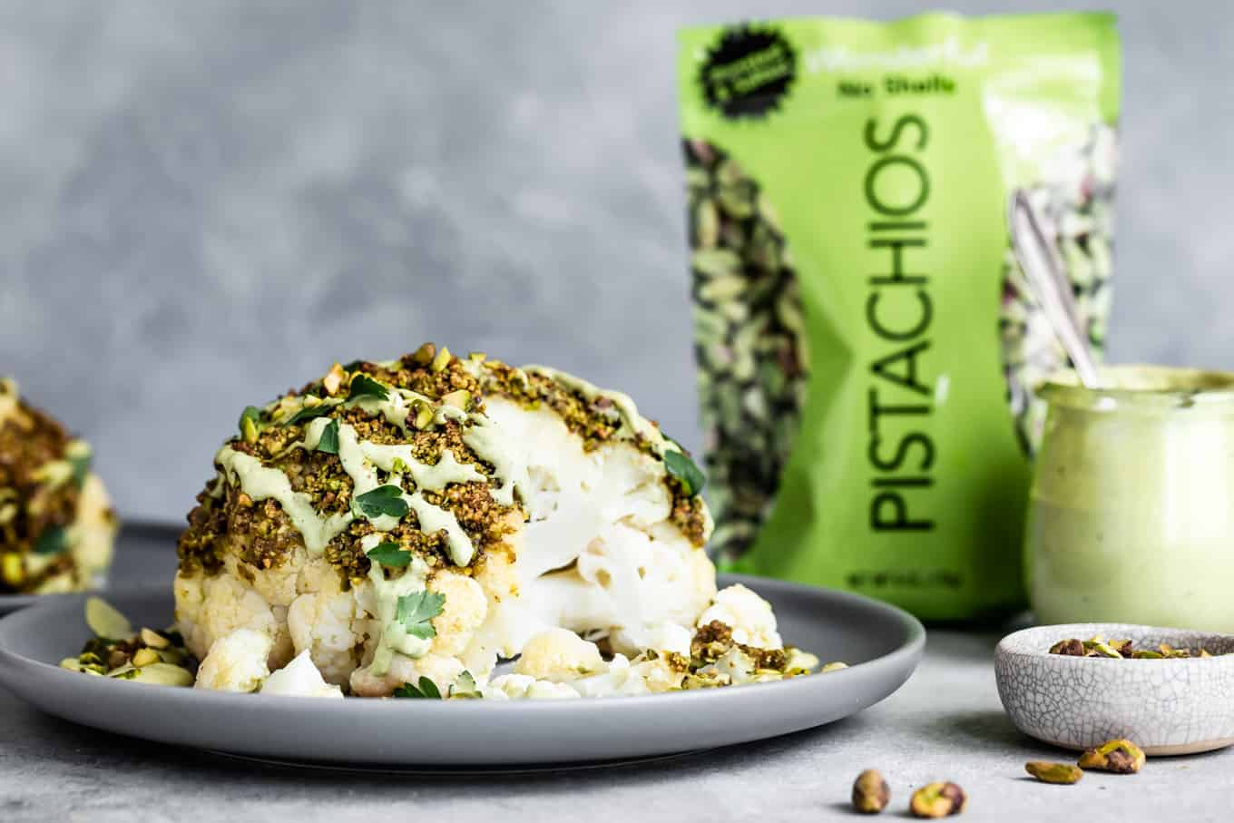Pistachio-Crusted Whole Roasted Cauliflower with Pistachio Cream SaucePistachio-Crusted Whole Roasted Cauliflower with Pistachio Cream Sauce