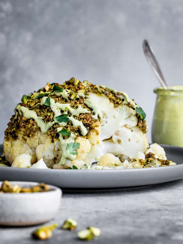 Pistachio-Crusted Whole Roasted Cauliflower with Pistachio Cream SaucePistachio-Crusted Whole Roasted Cauliflower with Pistachio Cream Sauce