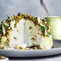 Pistachio-Crusted Whole Roasted Cauliflower with Pistachio Cream Sauce