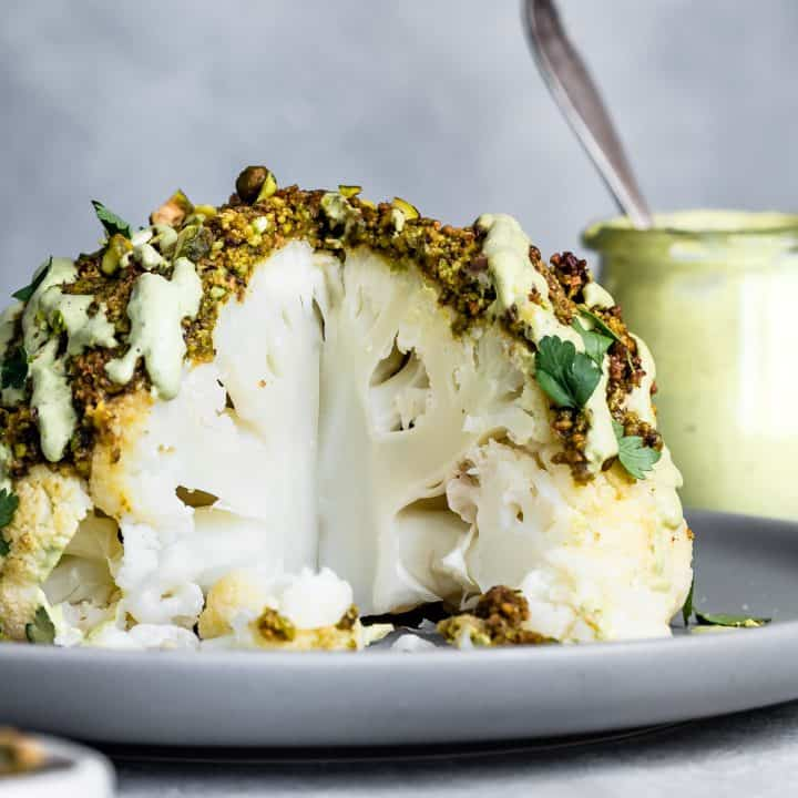 Pistachio-Crusted Whole Roasted Cauliflower with Pistachio Cream Sauce