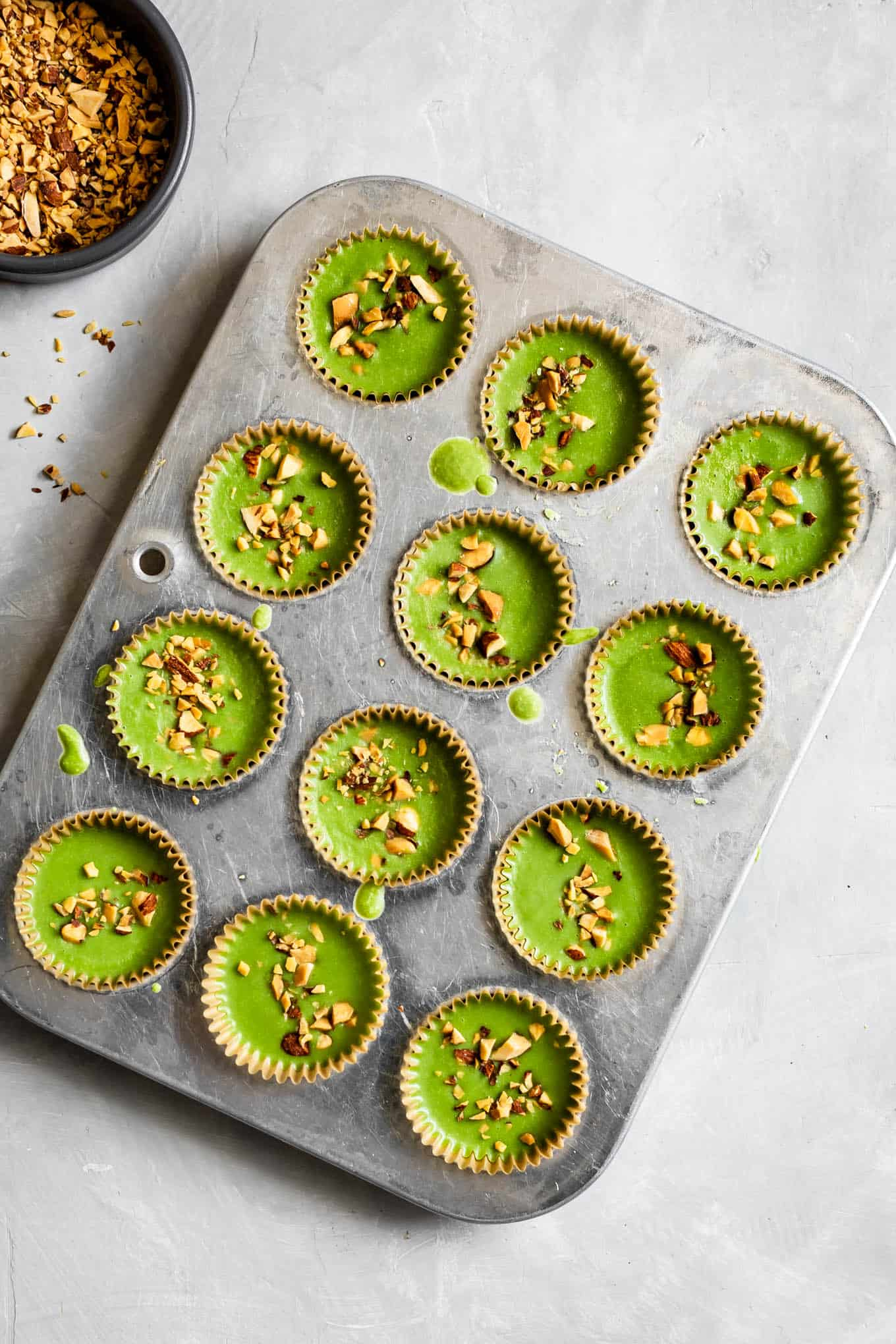 Chilled Coconut Matcha Almond Butter Cups in Mini Muffin Pan