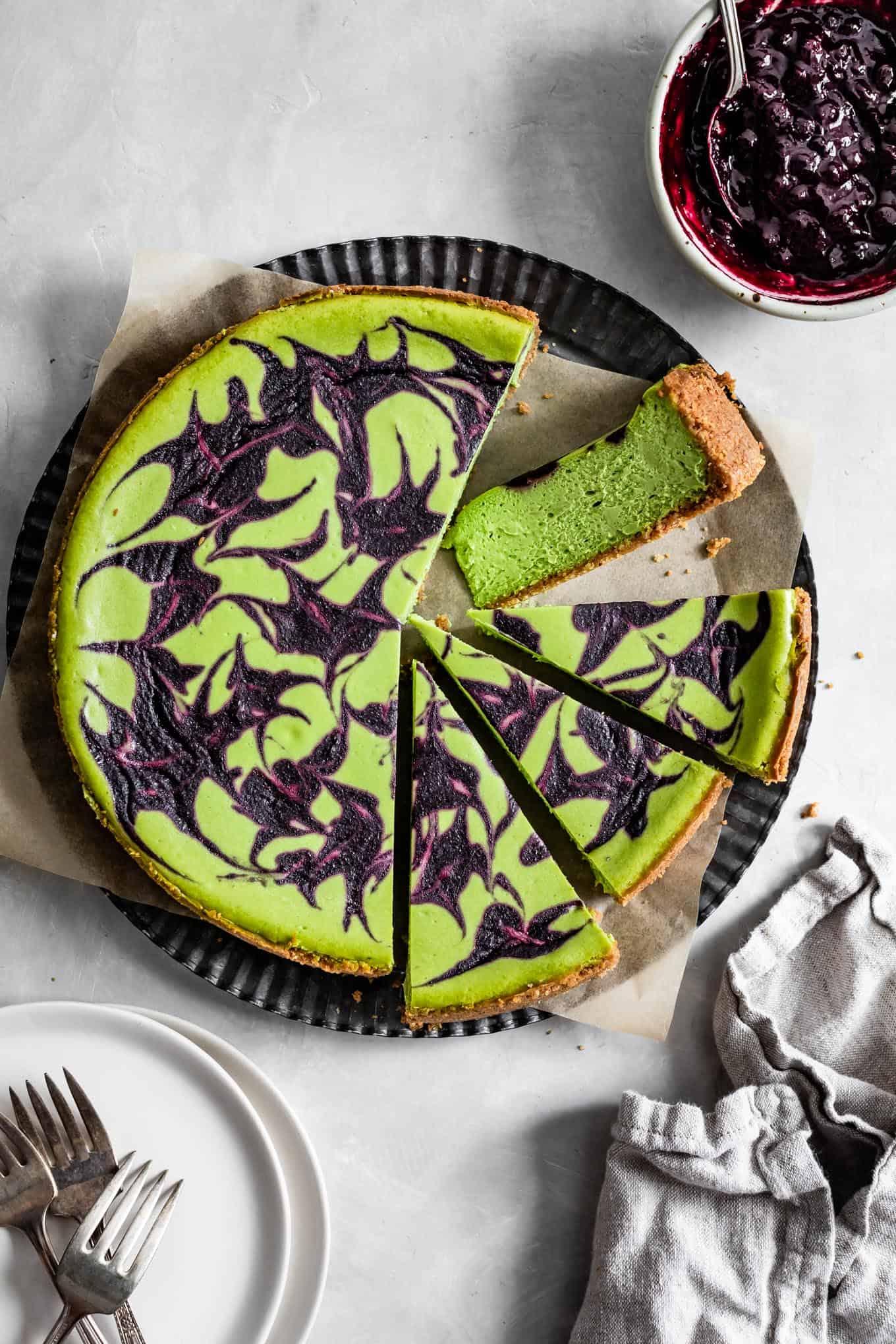 Baked Gluten-Free Matcha Cheesecake with Berry Swirl